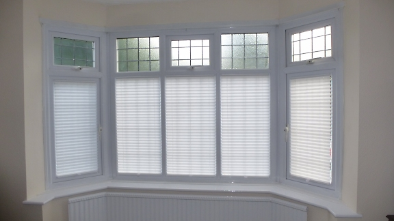 domestic pleated blinds in bay window