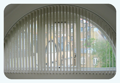 Arched Vertical Blind fitted by Saxon Blinds